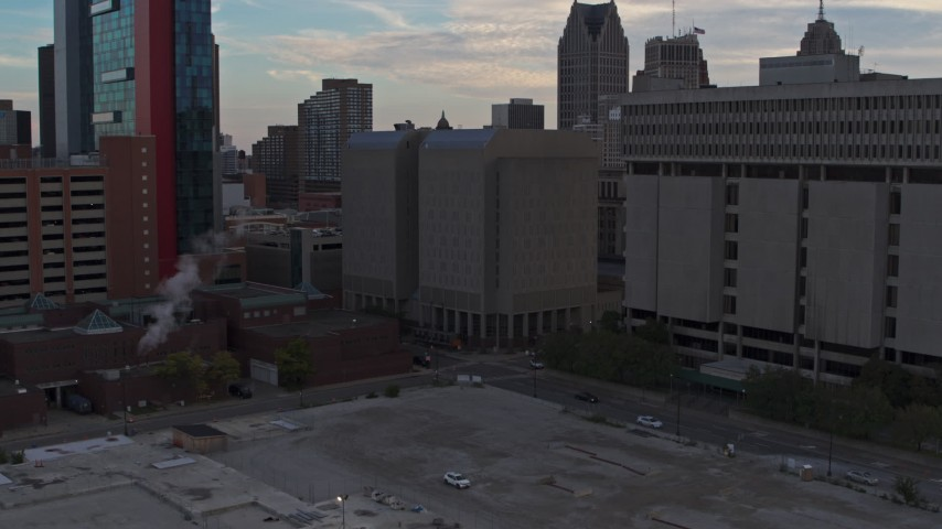 5.7K stock footage aerial video ascend while focusing on the Wayne County Jail Division 1 building at sunset, Downtown Detroit, Michigan Aerial Stock Footage | DX0002_192_032