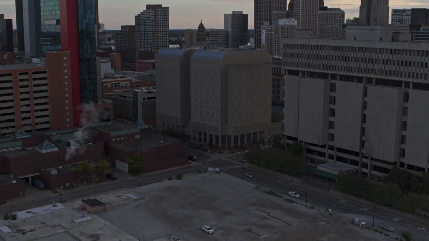 5.7K stock footage aerial video descend while focusing on the Wayne County Jail Division 1 building at sunset, Downtown Detroit, Michigan Aerial Stock Footage | DX0002_192_033