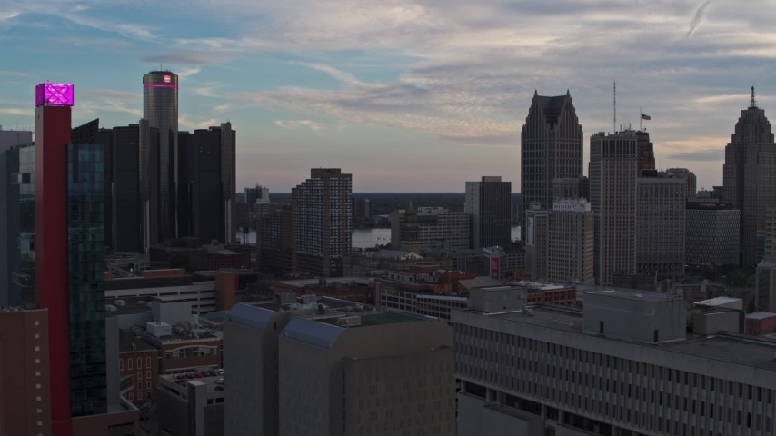 5.7K stock footage aerial video flyby a hotel at sunset and focus on the city's skyscrapers, Downtown Detroit, Michigan Aerial Stock Footage | DX0002_192_037