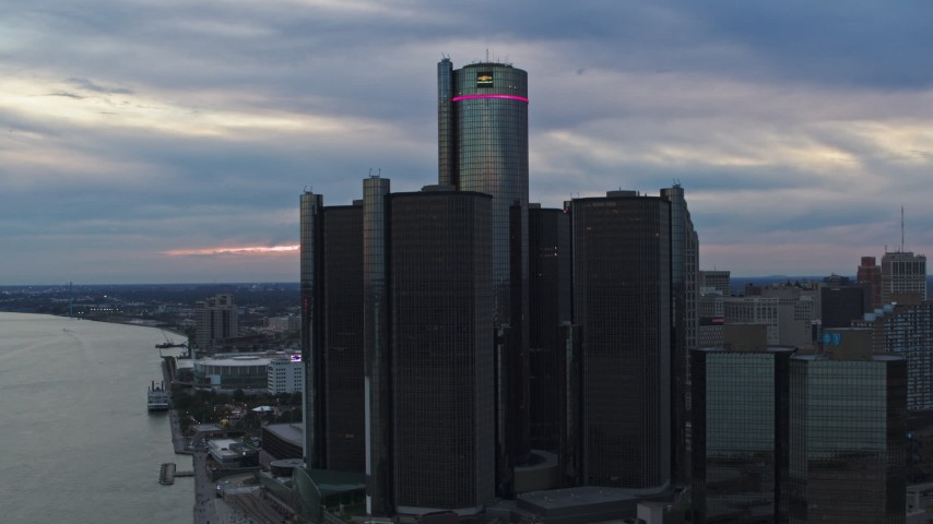 5.7K stock footage aerial video approach and orbit riverfront skyscraper at sunset, Downtown Detroit, Michigan Aerial Stock Footage | DX0002_192_039