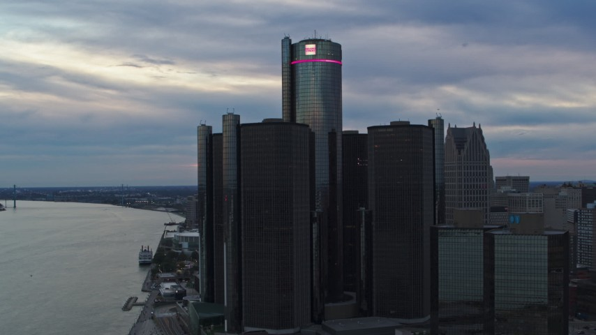5.7K stock footage aerial video approach the GM Renaissance Center skyscraper at sunset, Downtown Detroit, Michigan Aerial Stock Footage | DX0002_192_041
