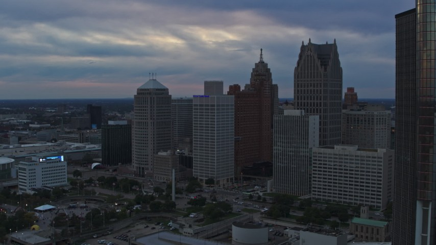 5.7K stock footage aerial video approach skyscrapers from the river at sunset, Downtown Detroit, Michigan Aerial Stock Footage | DX0002_192_043