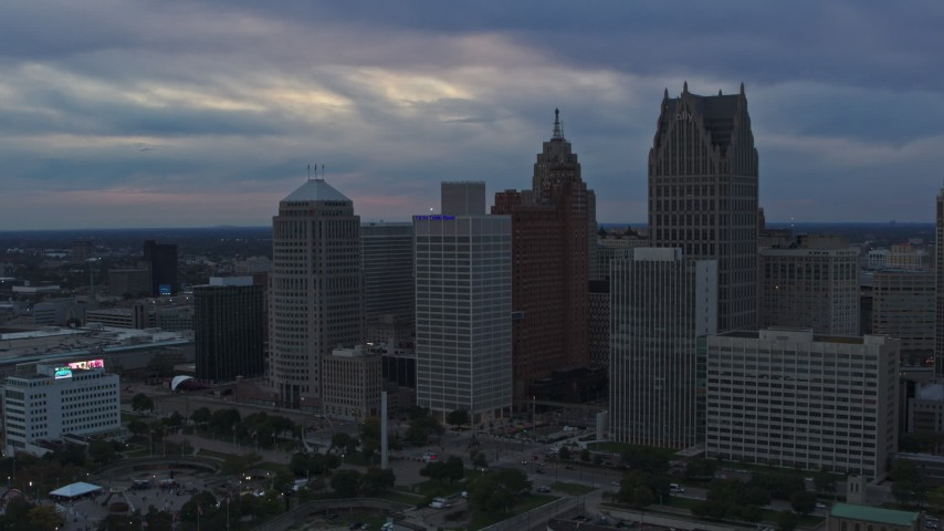 5.7K stock footage aerial video flyby skyscrapers and reveal GM Renaissance Center at sunset, Downtown Detroit, Michigan Aerial Stock Footage | DX0002_192_044