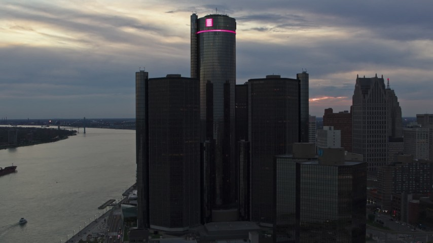 5.7K stock footage aerial video circling the GM Renaissance Center skyscraper at sunset, Downtown Detroit, Michigan Aerial Stock Footage | DX0002_192_050