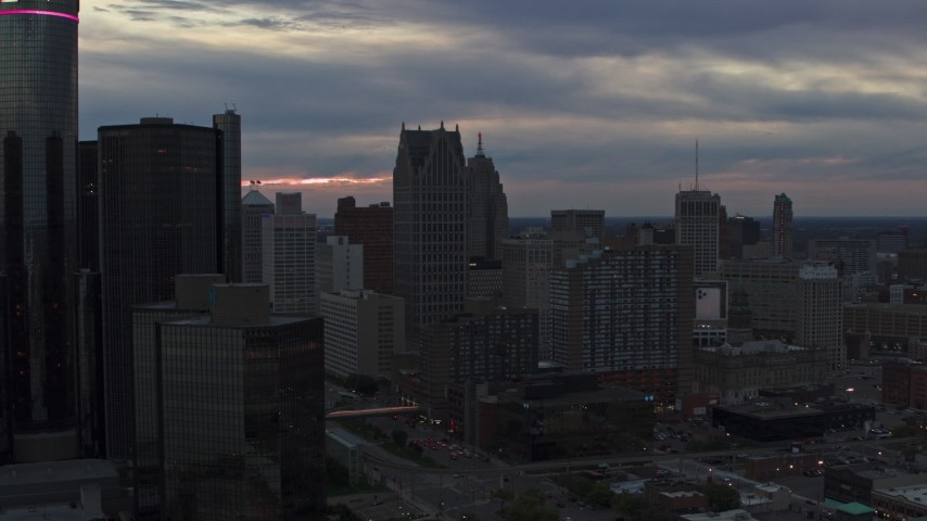 5.7K stock footage aerial video of skyscrapers at sunset, reveal GM Renaissance Center, Downtown Detroit, Michigan Aerial Stock Footage | DX0002_192_052