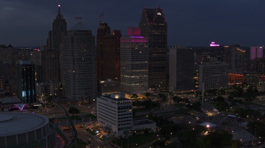 5.7K stock footage aerial video of orbiting tall skyscrapers at twilight, Downtown Detroit, Michigan Aerial Stock Footage | DX0002_193_001