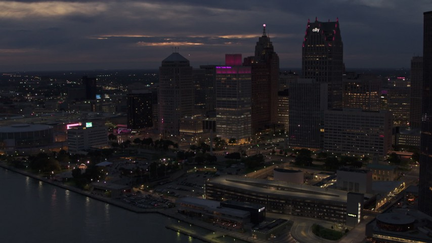 5.7K stock footage aerial video of tall downtown skyscrapers at twilight seen from the river, Downtown Detroit, Michigan Aerial Stock Footage | DX0002_193_003