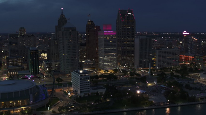 5.7K stock footage aerial video orbit a group of skyscrapers at twilight, Downtown Detroit, Michigan Aerial Stock Footage | DX0002_193_004