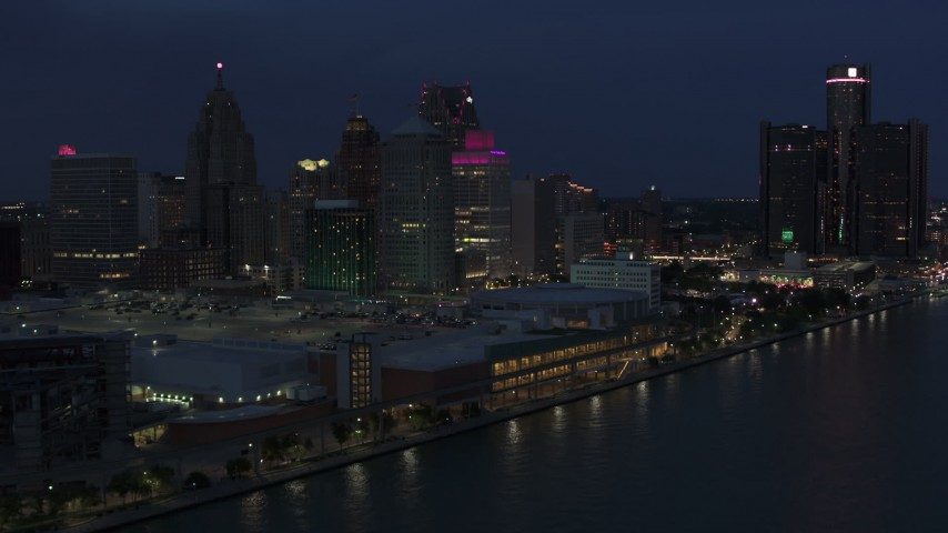 5.7K stock footage aerial video focus on skyscrapers while flying by convention center at twilight, Downtown Detroit, Michigan Aerial Stock Footage | DX0002_193_006