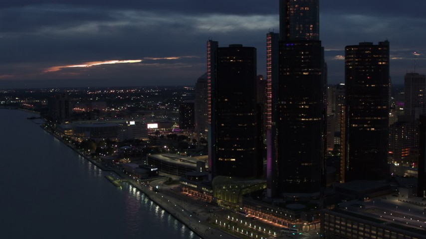 5.7K stock footage aerial video stationary view of GM Renaissance Center and Detroit River at twilight, Downtown Detroit, Michigan Aerial Stock Footage | DX0002_193_009
