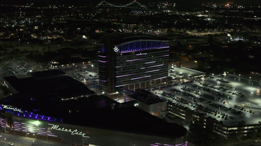 5.7K stock footage aerial video reverse view of lights on the MotorCity Casino Hotel building at night, Detroit, Michigan Aerial Stock Footage | DX0002_193_020