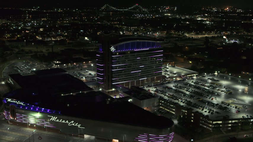 5.7K stock footage aerial video orbiting lights on the MotorCity Casino Hotel building at night, Detroit, Michigan Aerial Stock Footage | DX0002_193_021