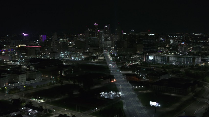 5.7K stock footage aerial video the city's skyline at night while passing Grand River Avenue, Downtown Detroit, Michigan Aerial Stock Footage | DX0002_193_023