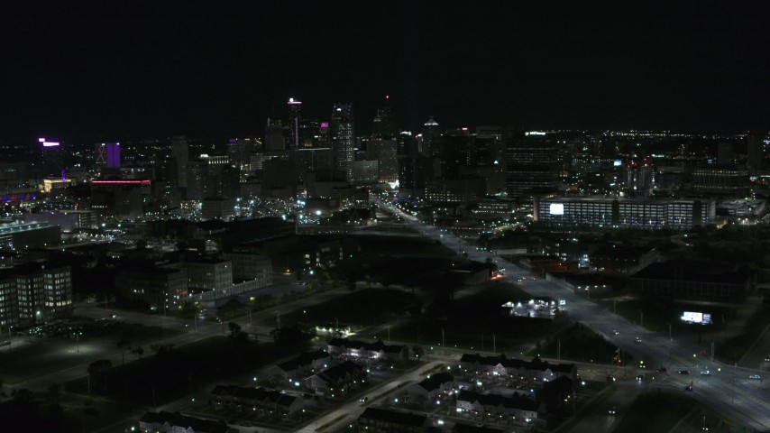 5.7K stock footage aerial video flying by Grand River Avenue with view of skyline at night, Downtown Detroit, Michigan Aerial Stock Footage | DX0002_193_024