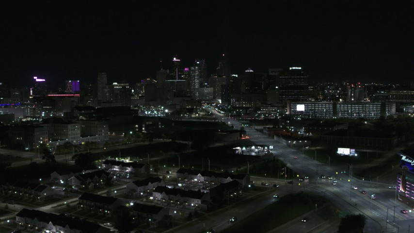 5.7K stock footage aerial video flying near Grand River Avenue while focused on skyline at nighttime, Downtown Detroit, Michigan Aerial Stock Footage | DX0002_193_025