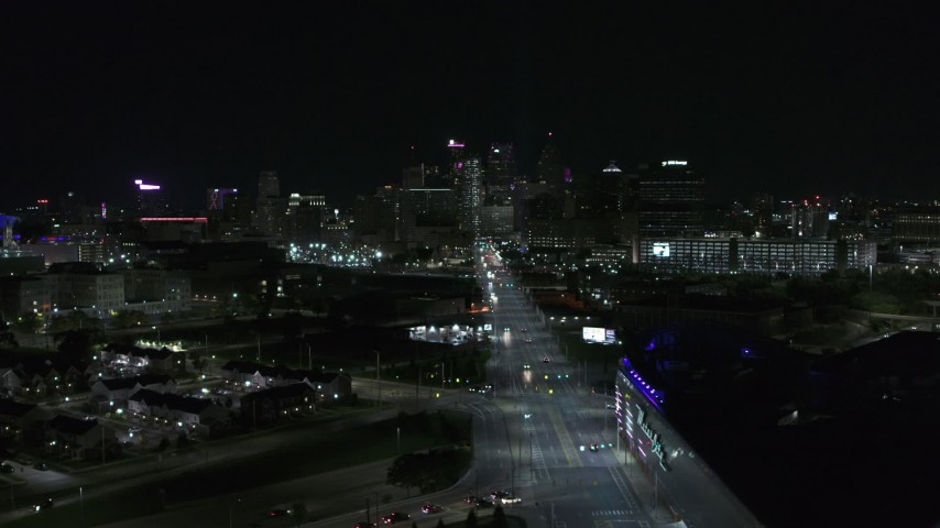 5.7K stock footage aerial video flying by Grand River Avenue, focus on skyline at night, Downtown Detroit, Michigan Aerial Stock Footage | DX0002_193_026