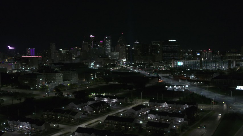 5.7K stock footage aerial video flying by the skyline at night and descend, Downtown Detroit, Michigan Aerial Stock Footage | DX0002_193_027