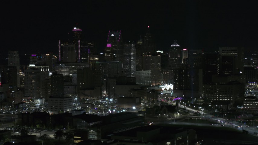 5.7K stock footage aerial video of the tall towers in the skyline at night, Downtown Detroit, Michigan Aerial Stock Footage | DX0002_193_031