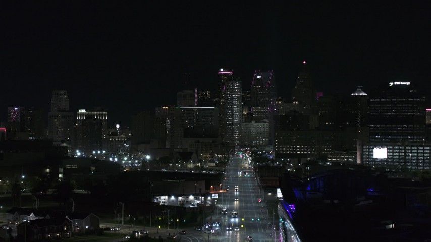 5.7K stock footage aerial video of the skyline at night during descent over Grand River Avenue, Downtown Detroit, Michigan Aerial Stock Footage | DX0002_193_032