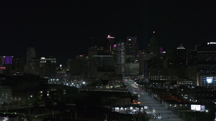 5.7K stock footage aerial video fly from Grand River Avenue, focus on skyline at night, Downtown Detroit, Michigan Aerial Stock Footage | DX0002_193_033