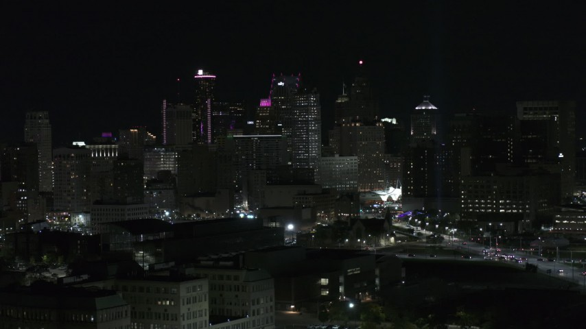 5.7K stock footage aerial video focus on skyline at night while descending, Downtown Detroit, Michigan Aerial Stock Footage | DX0002_193_034