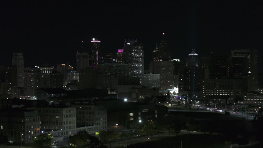 5.7K stock footage aerial video of flying past the city's skyline at night, Downtown Detroit, Michigan Aerial Stock Footage | DX0002_193_035