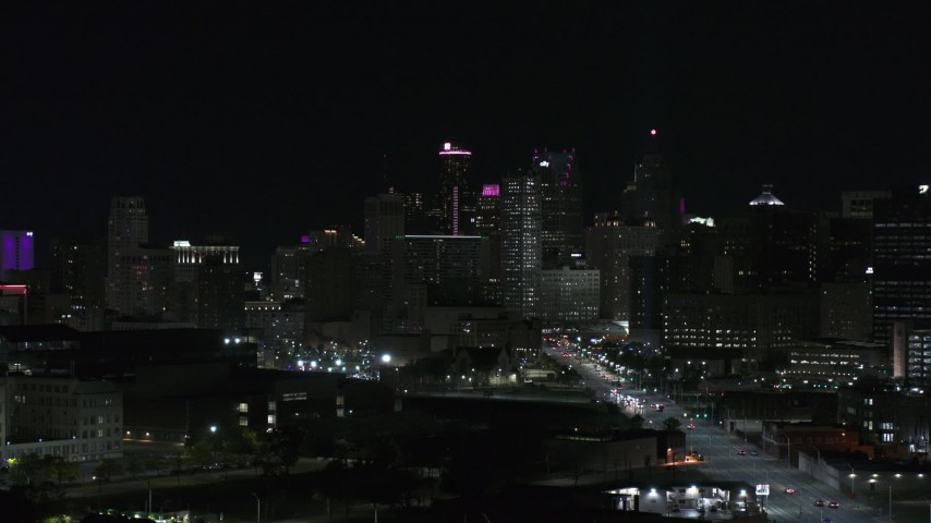 5.7K stock footage aerial video of towering skyscrapers in city's skyline at night during descent, Downtown Detroit, Michigan Aerial Stock Footage | DX0002_193_036
