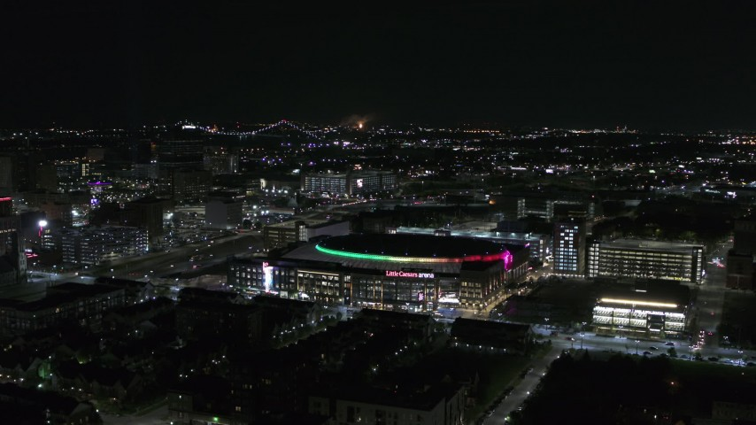 5.7K stock footage aerial video of circling Little Caesars Arena at night, Detroit, Michigan Aerial Stock Footage | DX0002_193_040