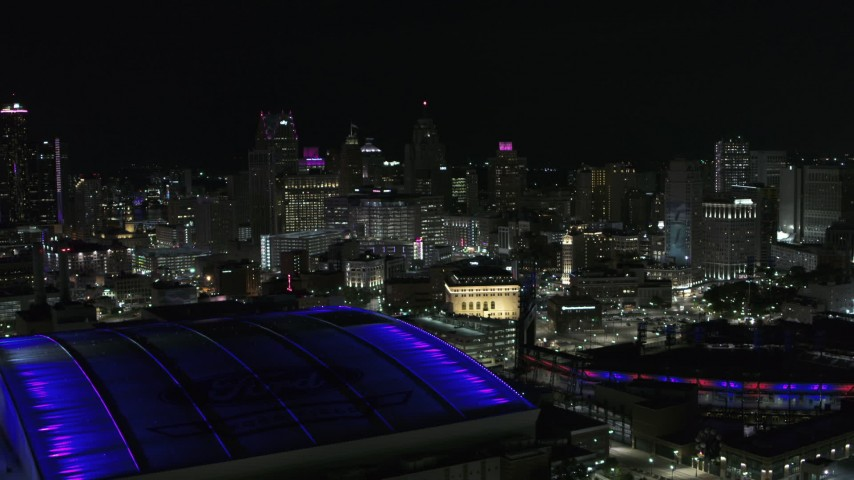 5.7K stock footage aerial video of the city's skyline at night, seen from the stadiums, Downtown Detroit, Michigan Aerial Stock Footage | DX0002_193_041