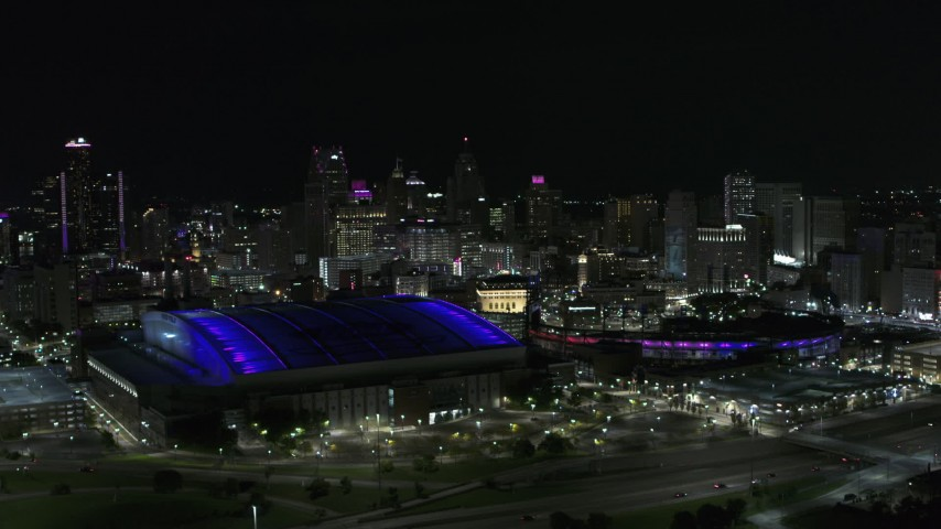 5.7K stock footage aerial video of the city's skyline and sports stadiums at night, Downtown Detroit, Michigan Aerial Stock Footage | DX0002_193_042