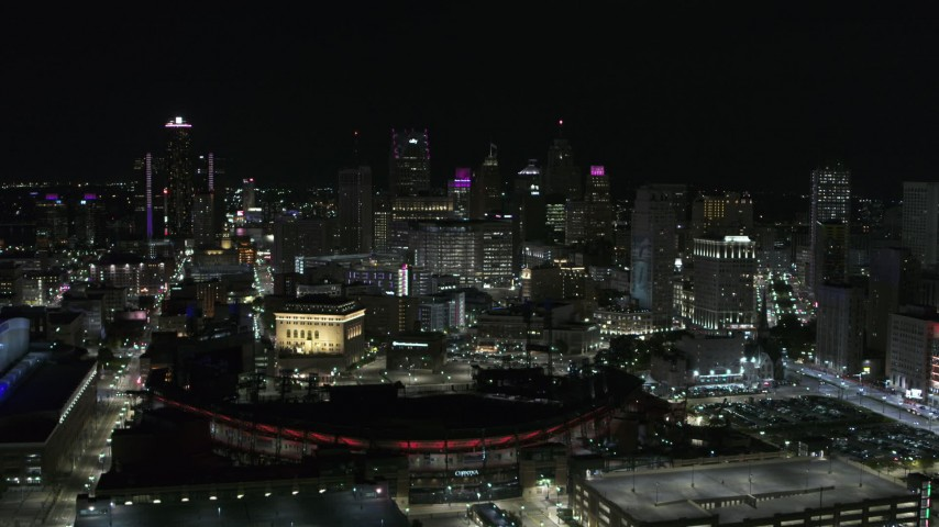 5.7K stock footage aerial video approach the city's skyline and baseball stadium at night, Downtown Detroit, Michigan Aerial Stock Footage | DX0002_193_043
