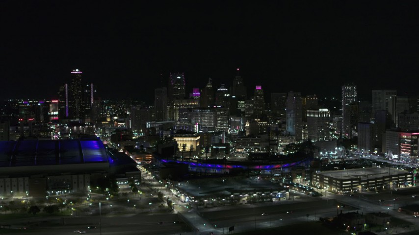 5.7K stock footage aerial video slowly approach the skyline, Ford Field and Comerica Park at night, Downtown Detroit, Michigan Aerial Stock Footage | DX0002_193_048