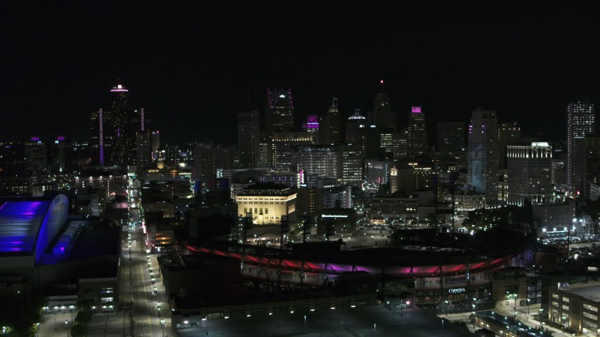 5.7K stock footage aerial video approach the skyline and Comerica Park at night before descent, Downtown Detroit, Michigan Aerial Stock Footage | DX0002_193_049