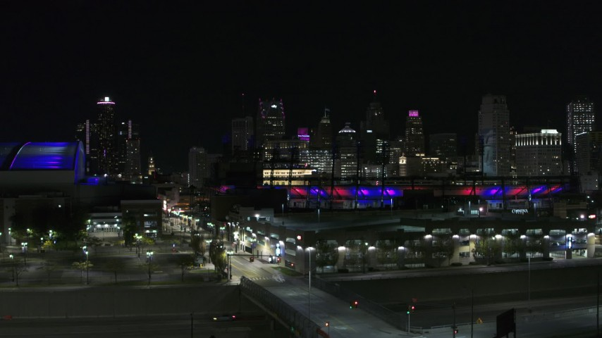 5.7K stock footage aerial video descend near Comerica Park at night with view of skyline, Downtown Detroit, Michigan Aerial Stock Footage | DX0002_193_050