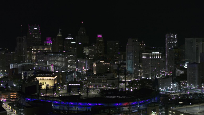5.7K stock footage aerial video ascend from Comerica Park and skyline at night, Downtown Detroit, Michigan Aerial Stock Footage | DX0002_193_051