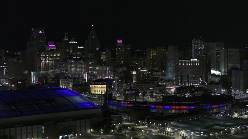 5.7K stock footage aerial video flyby sports stadiums and skyline at night, Downtown Detroit, Michigan Aerial Stock Footage | DX0002_193_052