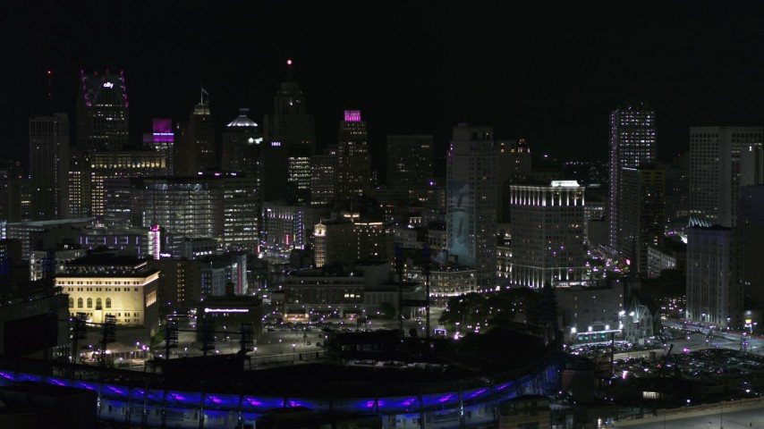 5.7K stock footage aerial video fly past skyline at night, reveal Comerica Park, Downtown Detroit, Michigan Aerial Stock Footage | DX0002_193_054