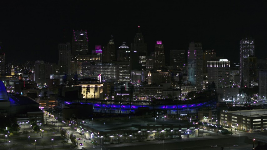 5.7K stock footage aerial video fly past Comerica Park and skyline at night, Downtown Detroit, Michigan Aerial Stock Footage | DX0002_193_056