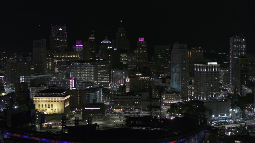 5.7K stock footage aerial video the downtown skyline seen from baseball stadium at night, Downtown Detroit, Michigan Aerial Stock Footage | DX0002_193_057