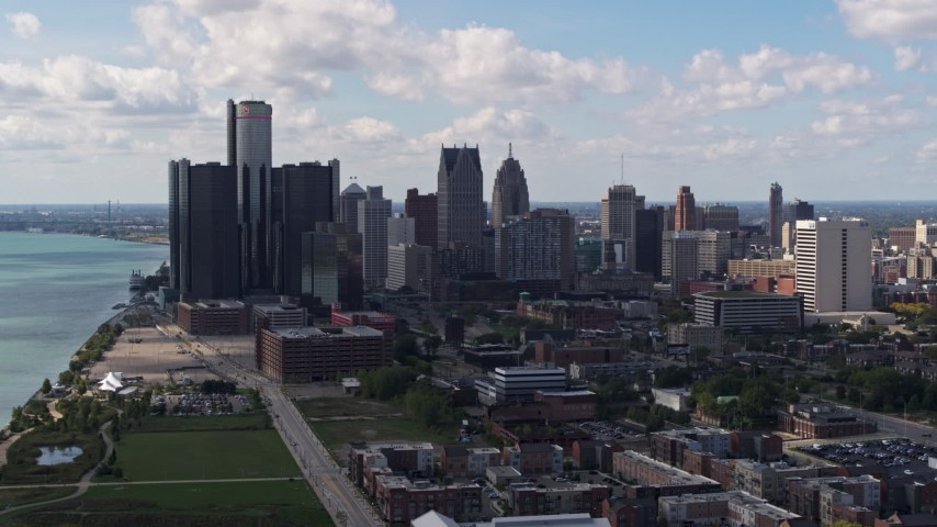 5.7K stock footage aerial video of flying by GM Renaissance Center and the city's skyline, Downtown Detroit, Michigan Aerial Stock Footage | DX0002_194_003