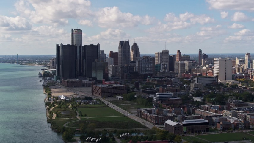 5.7K stock footage aerial video of flying away from GM Renaissance Center and the city's skyline, Downtown Detroit, Michigan Aerial Stock Footage | DX0002_194_004