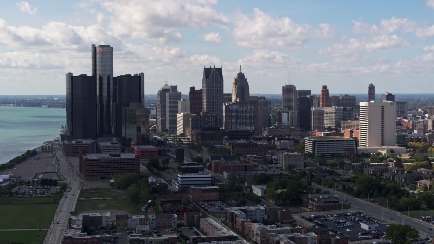 5.7K stock footage aerial video of passing by GM Renaissance Center and the city's skyline, Downtown Detroit, Michigan Aerial Stock Footage | DX0002_194_006