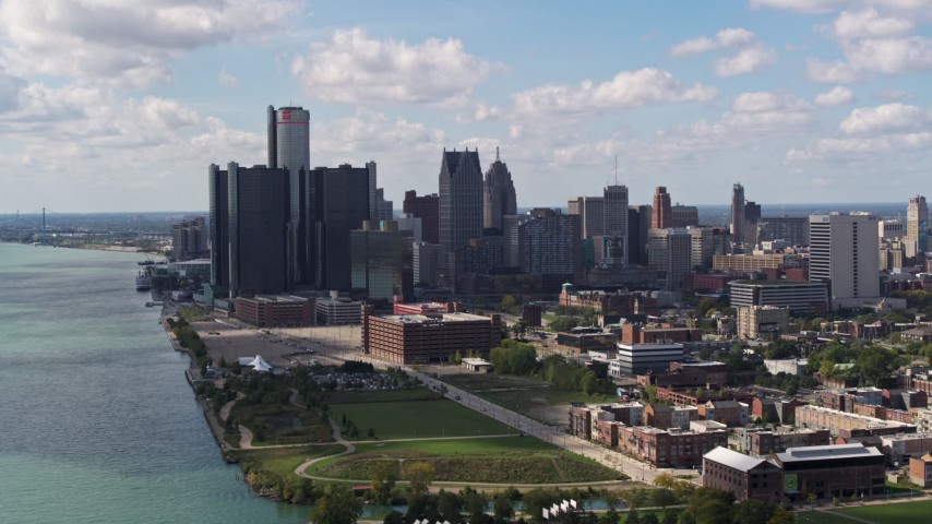5.7K stock footage aerial video of passing by GM Renaissance Center and the skyline in Downtown Detroit, Michigan Aerial Stock Footage | DX0002_194_010