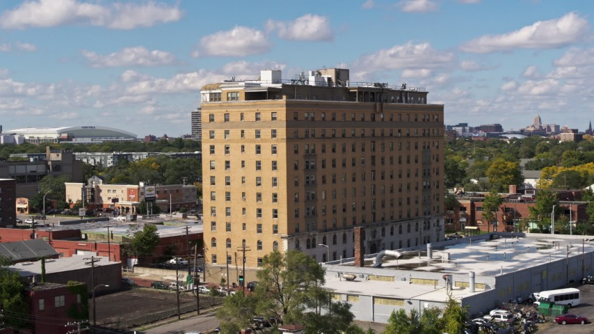 5.7K stock footage aerial video of circling an apartment building in Detroit, Michigan Aerial Stock Footage | DX0002_194_015