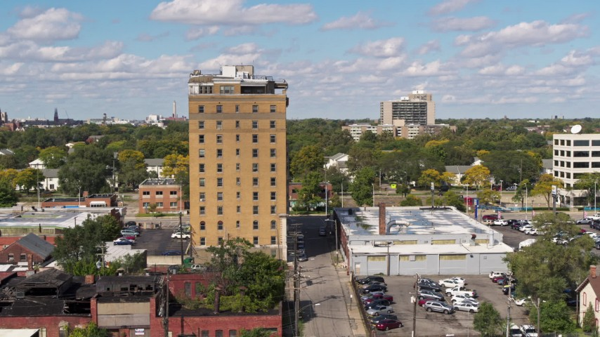 5.7K stock footage aerial video of slowly orbiting an apartment building in Detroit, Michigan Aerial Stock Footage | DX0002_194_016