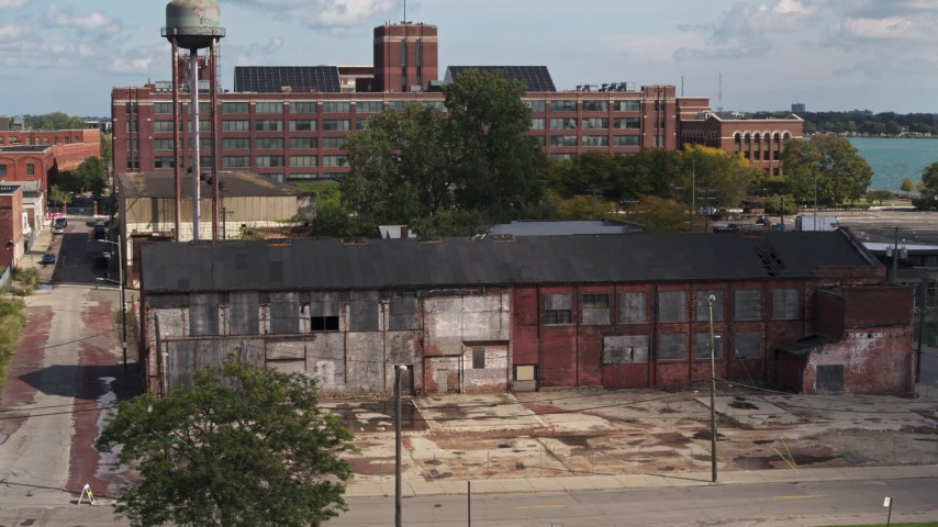 5.7K stock footage aerial video reverse view of an abandoned factory building in Detroit, Michigan Aerial Stock Footage | DX0002_194_019