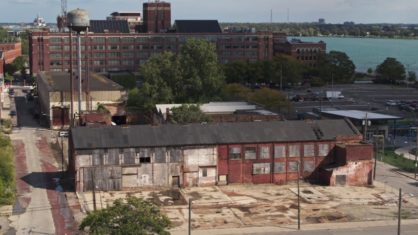 5.7K stock footage aerial video ascend by an abandoned factory building in Detroit, Michigan Aerial Stock Footage | DX0002_194_021