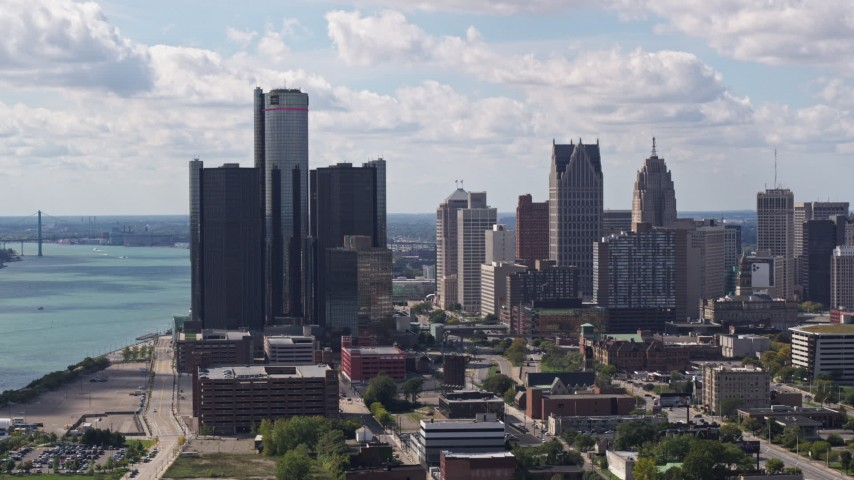 5.7K stock footage aerial video of slowly passing towering GM Renaissance Center and the skyline in Downtown Detroit, Michigan Aerial Stock Footage | DX0002_194_024