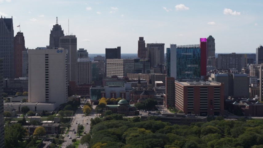 5.7K stock footage aerial video of churches between office building and the hotel and casino, Downtown Detroit, Michigan Aerial Stock Footage | DX0002_194_041
