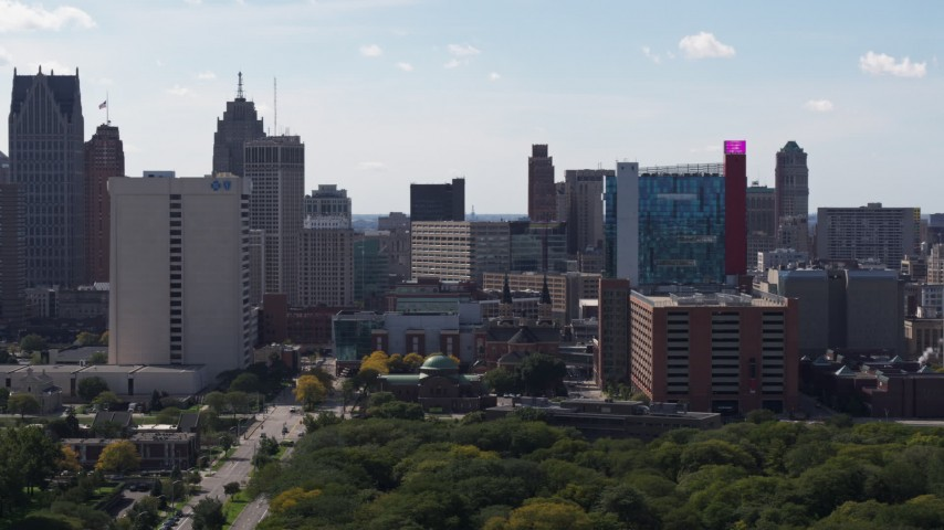 5.7K stock footage aerial video of churches between office tower and the hotel and casino, Downtown Detroit, Michigan Aerial Stock Footage | DX0002_194_042